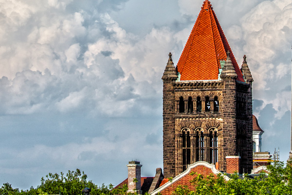 Altgeld Bell Tower framed by clouds on a summer day.