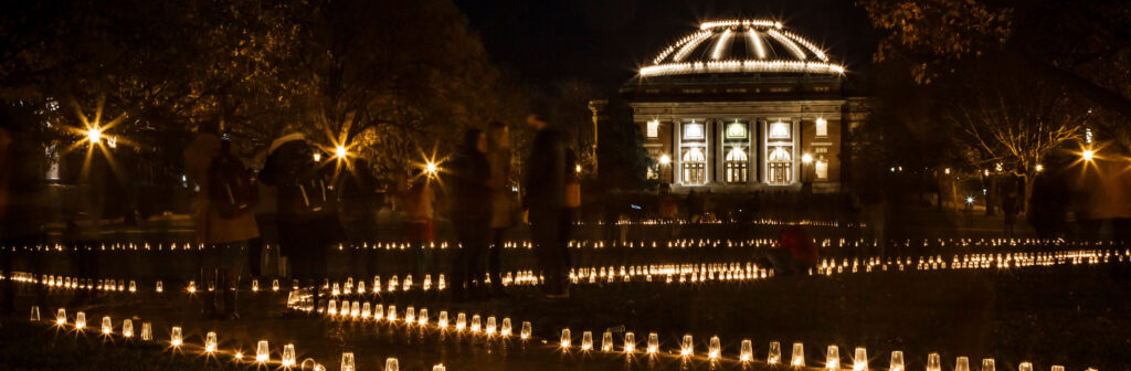 Diwali, Indiian Festival of Lights on University of Illinois Quad. The paths are lined with candles. The dome of Foellinger is lit.